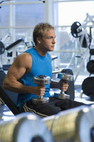 Popular : Man weightlifting with dumbbells