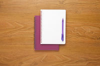 Notebook and pen on desk background with copy space