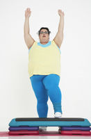 Overweight woman doing gymnastics
