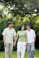 Popular : Parents and son walking in the park