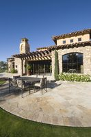 Paved dining area of palm springs hacienda