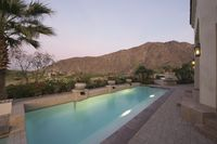 Paved poolside area of palm springs home