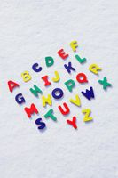 Plastic alphabets in snow