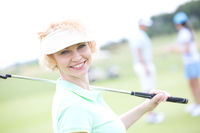 Popular : Portrait of happy female golfer holding golf club
