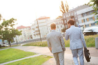 Popular : Rear view of businessmen walking at park on sunny day