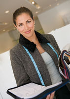 Saleswoman in furniture store with organizer and swatches portrait