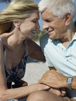 Senior couple holding hands on tropical beach close up