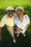 Senior couple on golf course smiling  portrait   elevated view