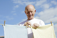 Popular : Senior man hanging clothes on the clothesline