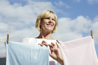 Popular : Senior woman hanging clothes on the clothesline