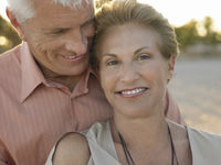 Smiled senior couple on tropical beach close up
