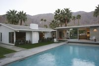 Swimming pool and palm trees palm springs home