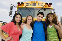 Teenagers by school bus