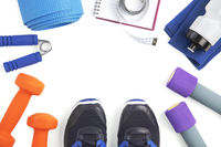 Top view of fitness equipment on white background with copyspace