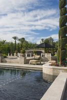 Topiary in garden with poolside sunlounger palm springs