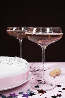 Two champagne glasses and cake close up