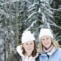 Two women in warm clothing smiling at the camera