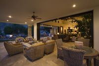 Wicker furniture in lit palm springs home