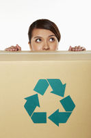 Popular : Woman hiding behind a recyclable cardboard box