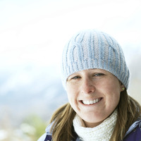Woman in knitted hat smiling at the camera