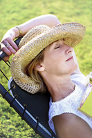 Woman in straw hat taking a nap