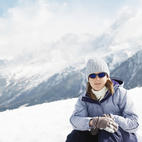 Woman in warm clothing and sunglasses