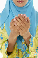 Popular : Woman praying with palms placed together