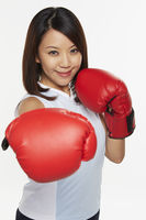 Popular : Woman wearing boxing gloves