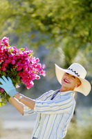 Woman with gloves gardening