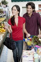 Young couple food shopping in supermarket