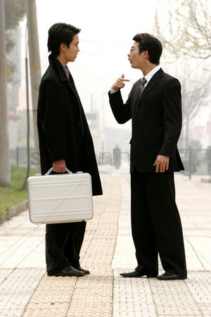 Client : A bespectacled man scolding his colleague