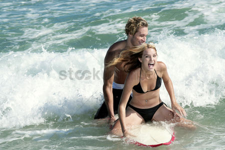Lover : A couple surfing together on the sea