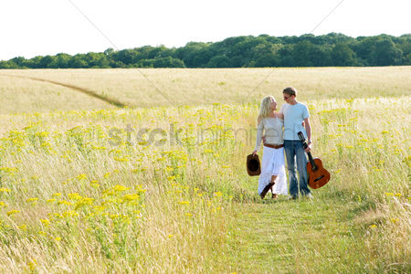 Grass : A couple walking together on the prairie