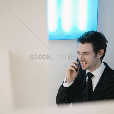 Adulthood : A guy in suit using cell phone
