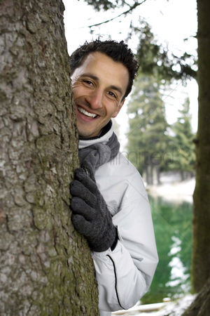 Coldness : A man hiding behind a tree