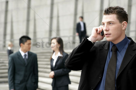 Stairs : A man in business suit talking on the hand phone