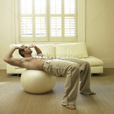 Furniture : A man on fitness ball