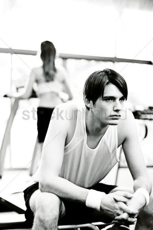 Workout : A man sitting at the gymnasium