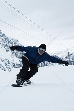 Adulthood : A man snowboarding