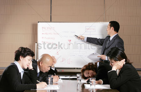 Business suit : A man teaching while the others sleeping