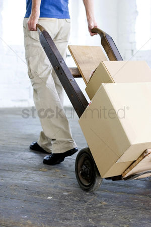 Strong : A man transferring goods using trolley