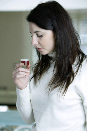 Ache : A woman with cough syrup in hand