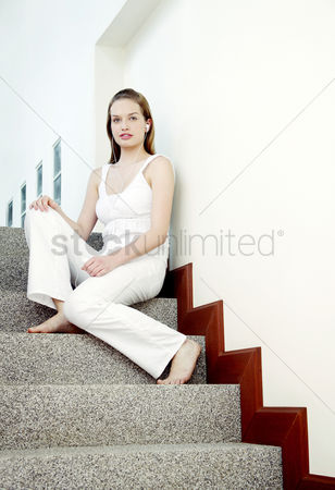 Adulthood : A young lady sitting at the staircase