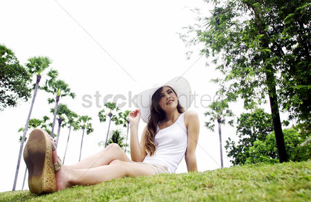Adulthood : A young lady sitting on the grass