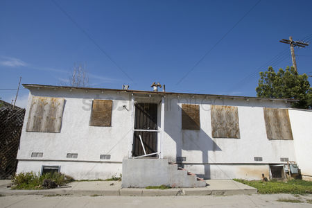 Loss : Abandoned house with boarded up windows