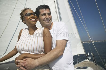 Women group outside : Affectionate couple relaxing on yacht