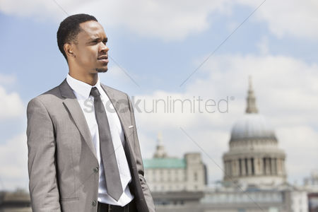 British ethnicity : African american businessman looking away with st  paul s cathedral in the background