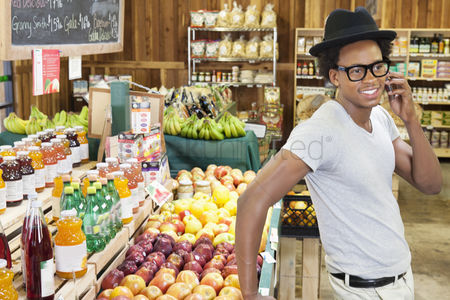 Supermarket : African american man using cellphone at supermarket