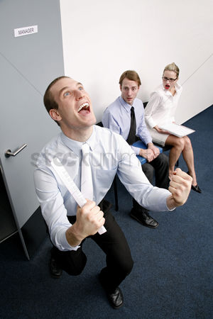 Sales person : An overjoyed businessman after passing a job interview