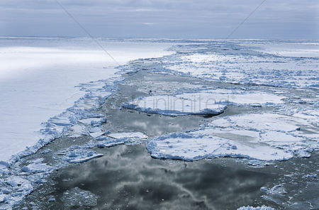 Moody : Antarctica weddell sea ice floe clouds reflecting in water